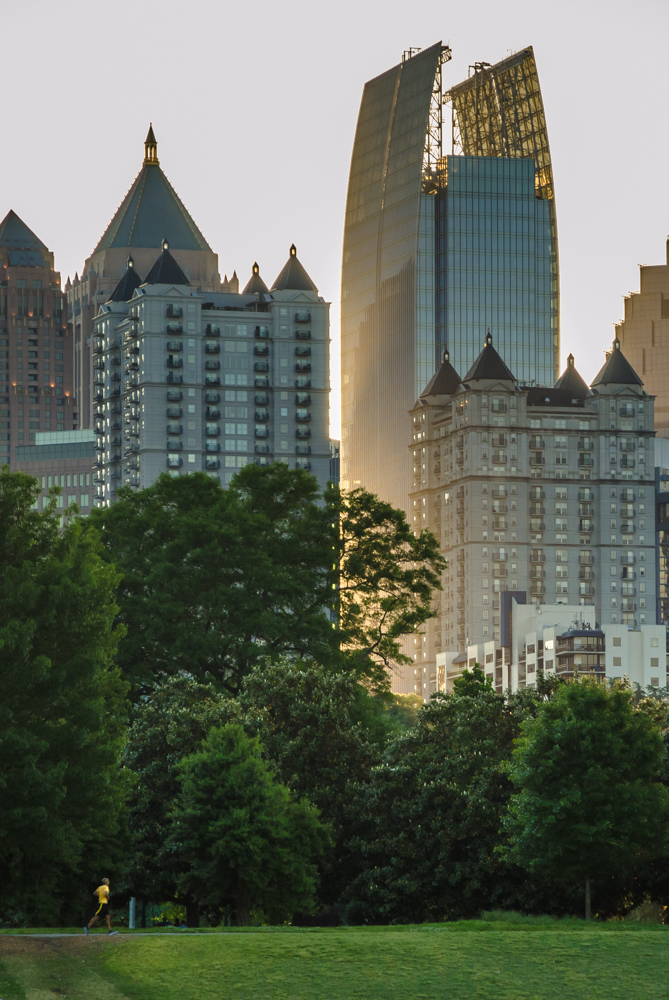 1180 Peachtree, known as Symphony Tower and seen here from The Meadow in Peidmont Park, rises above its neighbors in the Midtown district of Atlanta, Georgia.
