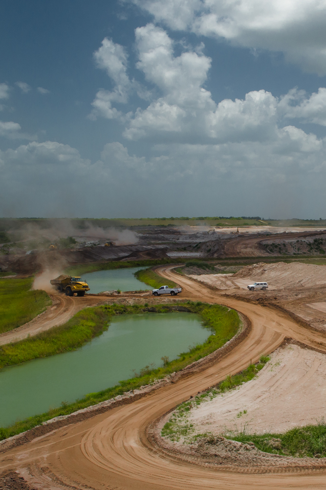 Phosphate Rock Mine, FloridaWork vehicles cross a canal at a phosphate rock mine in Florida.