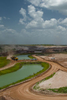 Work vehicles cross a canal at a phosphate rock mine in Florida.