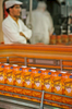 Fruit juice packaging line, BelgiumA supervisor watches over an orange juice packaging line at a fruit juice processing plant in Belgium.