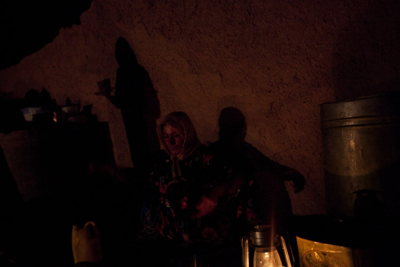 Kharaman Ibrahim Mohammed washes dishes by the light of a lantern in Showara.