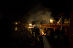 A funeral pyre burns at night beside the Pashupatinath Temple along the holy Bagmati River in Kathmandu.