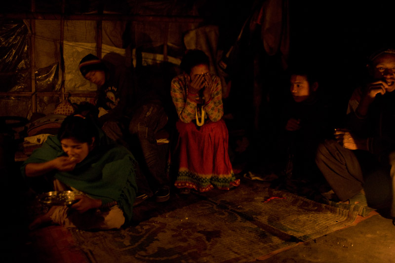 A family gathers for dinner in their home in Kathmandu.