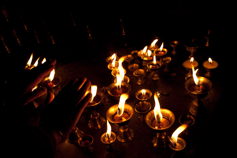 Candles burn outside a temple in Kathmandu.