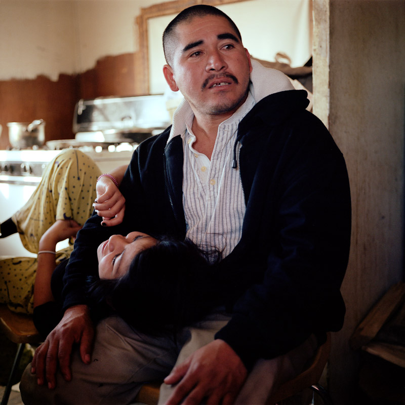 Isidro Alcudia and his teenage daughter, Roxanna, in their home in Pajarito Mesa.