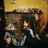 11-year-old Jack lies by a coal fire to keep warm while visiting his grandmother, Sylvia Burt, in Newtonstewart, Northern Ireland. {quote}We just don't get enough money to heat the house,{quote} says Sylvia, who sleeps in the living room with the fireplace and spends most of her day there.