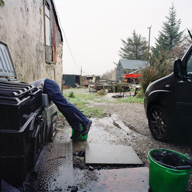 Jack gets the last of the coal at his grandmother's house to feed her coal fire in Newtonstewart, Northern Ireland.