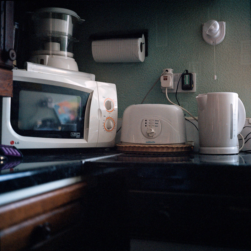 Unused household appliances in the kitchen of Richard Latham's home in Solihull.