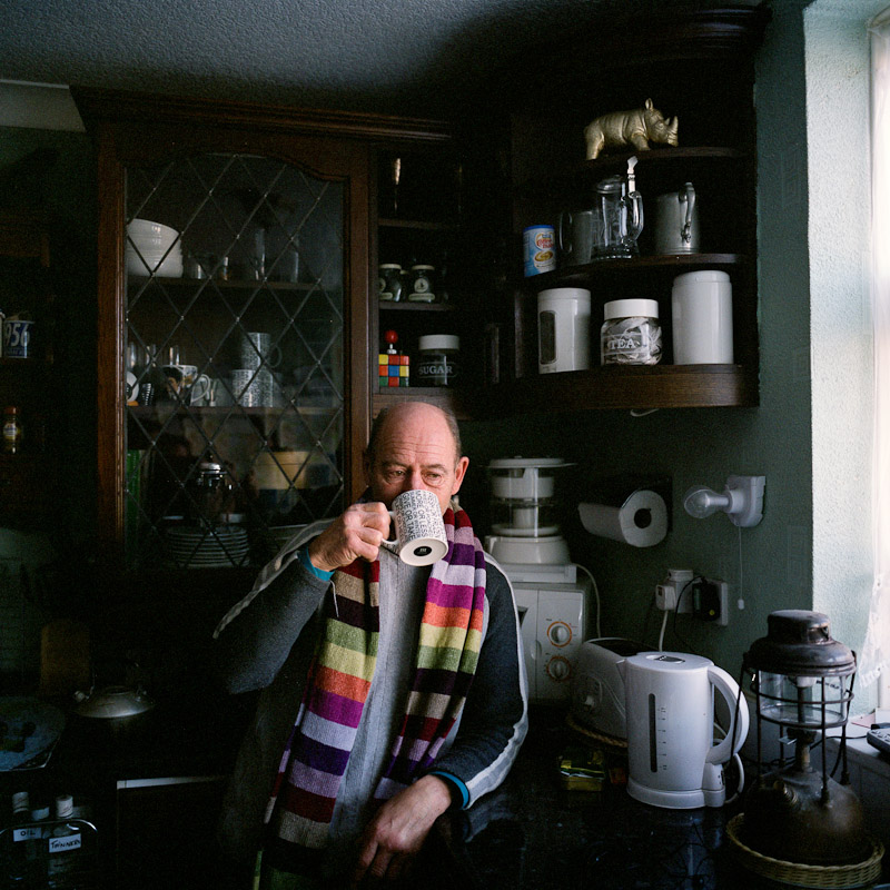 Richard has a cup of tea in his home in Solihull. Heating water for tea - once a day - is the only regular use of electricity he allows himself.