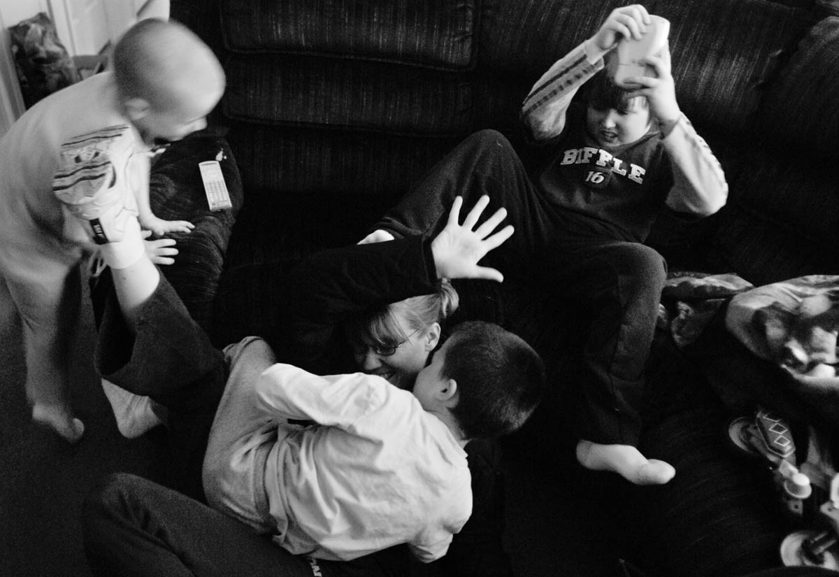 """Attack,"" Ryan yells as he jumps onto his mom and brother Mac who were already in the middle of a tickle fight April 13, 2007.  The Millers worry that they have been neglecting the boys because of all the attention they need to pay to Kyla. ""Our priority is her… and doing everything we can to keep her happy and here as long as possible,"" Stephanie said."