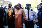 John Thornton, Jr., left, and Washington Park Police Chief Calvin Hammond, right, comfort Sharon Thornton, center, as they walk into the funeral service held for Washington Park mayor John Thornton, Sr. at Mount Calvary Church of God in Christ in Washington Park. Thornton was shot and  killed April 1, 2010.