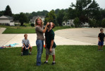 Krista holds Brendan's nose after it starts to bleed while playing a game of touch football in the front yard.