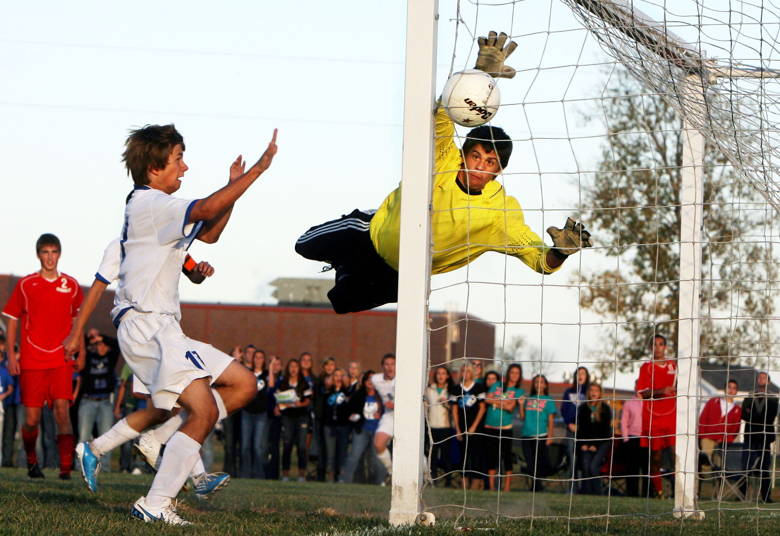 Gibault goalkeeper Auggie Sexauer tries to reach for the game winning goal shot from the opposite corner by Columbia's Blake Byrd during the Illinois Boys Class A Soccer Regional Final at Central Community High School in Breese. Columbia won 1-0. Also pictured is Columbia's Kyle Gudeman (17).