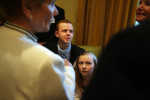 Surrounded by adults, Brendan and his sister Maddie wait for the Rosemary Zandar awards to begin.