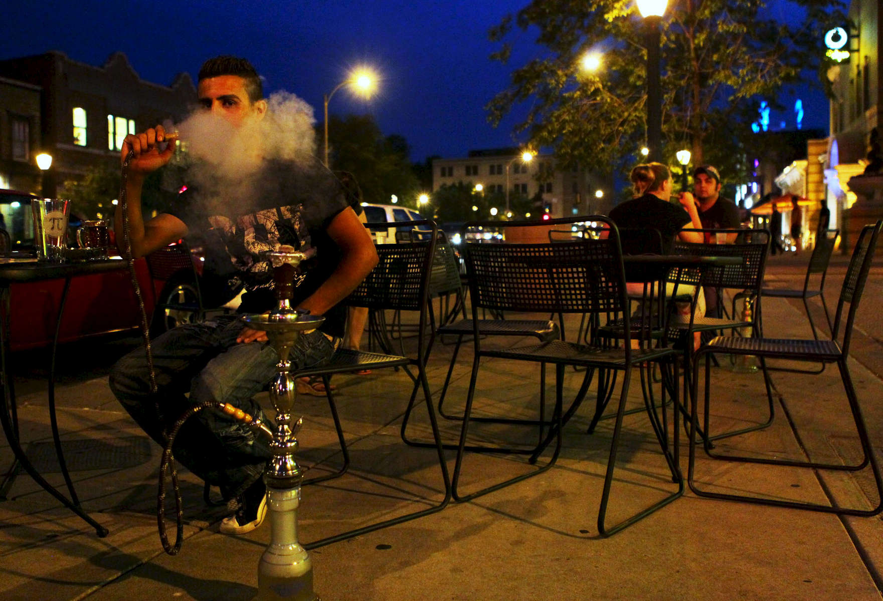 Ali Abdulrazzak blows out a puff of smoke at Ranoush Nights, a new venue in the Loop.