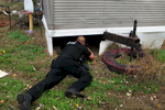 A Belleville police officer investigates the scene where a robbery suspect was found hiding under a mobile home.According to Belleville detective  Mark Hefferman, Police received a call around 6:40 am Monday morning about a robbery at the Circle K in Belleville. Police identified the car involved and attempted to make a traffic stop. The car fled and both suspects were found in unincorporated Collinville. One suspect was arrested without incident, the other was found under a mobile home in the 3200 block of University Street.