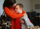 Brendan gets a hug and a kiss from his cousin is Kaylyn Weber after she spent the afternoon hanging out with him while his mom, a part-time  real estate agent, showed a home.