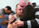 Far right, Tom Fuller hugs Nicole Caraker and her fiance Matthew Standfield after Shiloh Baptist Church's congregation held their service at Glad Tidings Church in Catawissa. Shiloh Baptist Church was severely damaged during the tornadoes that struck the area New Years Eve. {quote}God does everything for a reason,{quote} Fuller reassured his friends. Also pictured in the background is  Rev. George Fulgham hugging Bonnie Kommer.