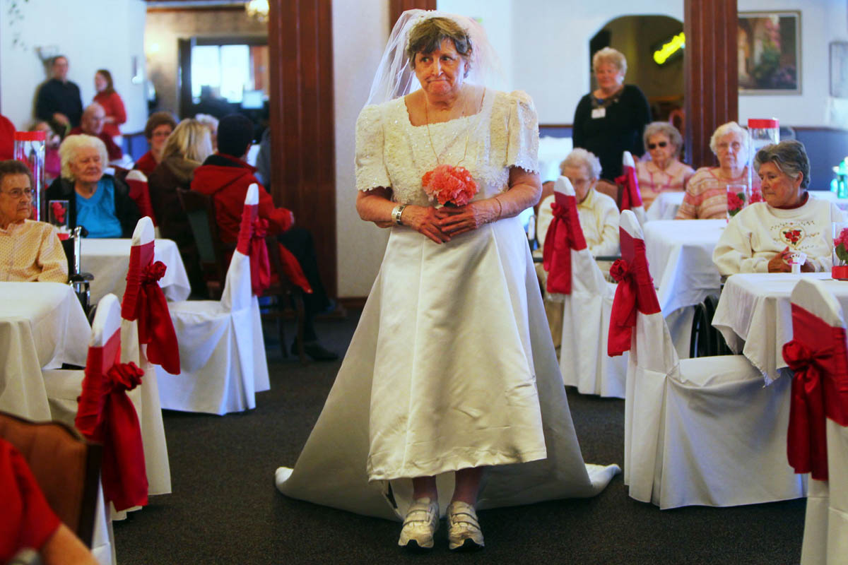 Dorothy Nilhaus models spring bridal wear during a fashion show at the Bethesda Southgate Skilled Nursing Community in honor of Valentines day. {quote}It's always fun to do something crazy. If you're going to get a laugh out of it, it's great,{quote} she said. Nineteen residents of the community participated in the event. Makeup was donated by Mary Kay Cosmetics and the clothes were donated by Callahan's Tuxedos and Bridal Shop.