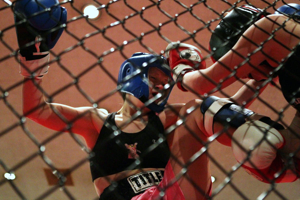 Left, Rachel Wessling and Elle Fischer battle it out in their Muay Thai bout. They were they only female fight at Fight 4 Cause at the Machinist Hall in Bridgeton.
