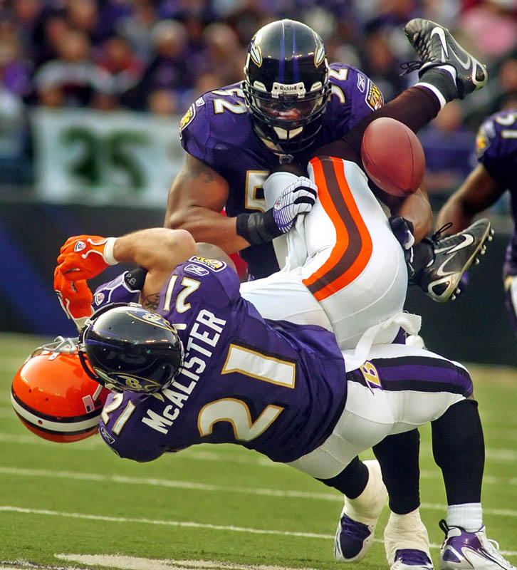 Cleveland Brown's Joe Jurevicius is taken down by Baltimore Raven's Chris McAlister and Ray Lewis during the first half of the Raven's 27-17 win over the Browns at M&T Bank Stadium in Baltimore.
