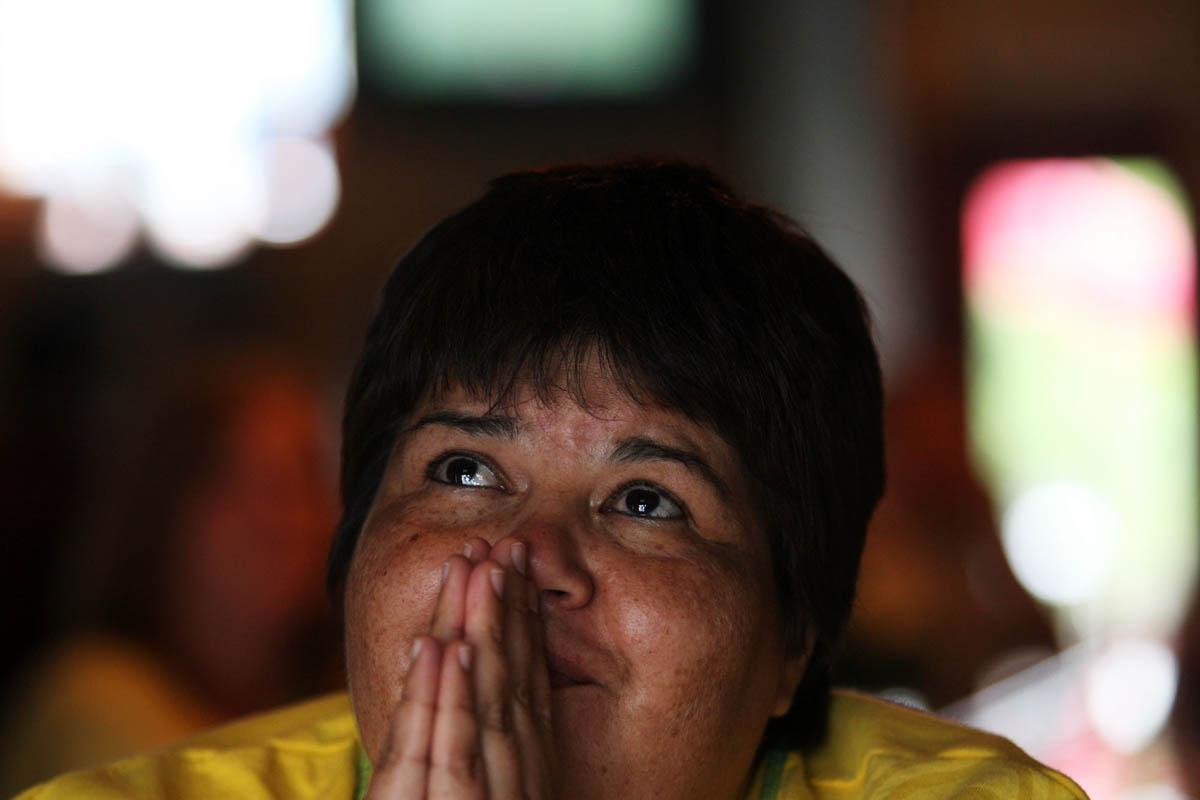 Minerva Lopez prays as she watches the end of the Athletica's game at a watch party at Amsterdam Tavern in St. Louis. The Athletica took on the Washington Freedom in Washington DC. The freedom came out on top 1-0.