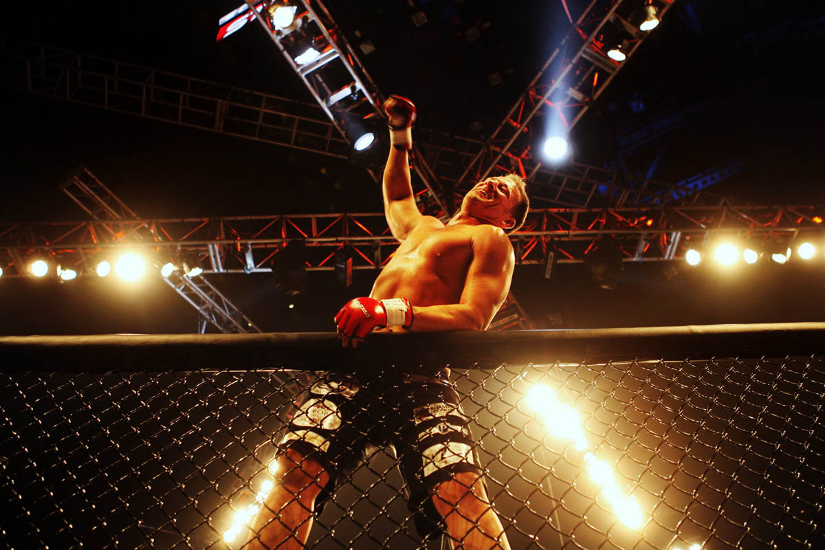 Jesse Finney, of St. Louis, jumps on the cage and celebrates after beating Justin DeMoney, of Ottumwa, Ia. Demoney tapped out in the first round during Strikeforce: Heavy Artillery at Scottrade Center in St. Louis.