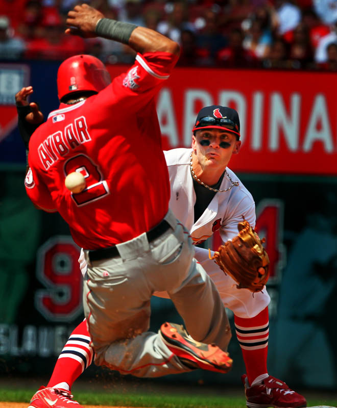 Angels' Erick Aybar slides into second base as he is hit by a throw from Albert Pujols to Brendan Ryan in the fifth inning as the St. Louis Cardinals take on the Los Angeles Angels at Busch Stadium. Aybar was safe at second on the hit by Angels' Howie Kendrick.