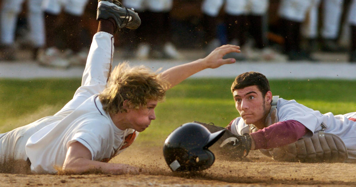 Schaumburg catcher Dominick D'Agata and Hersey' s Josh Harwell try to beat each other to homeplate Monday at Hersey High School.  Harwell was safe.