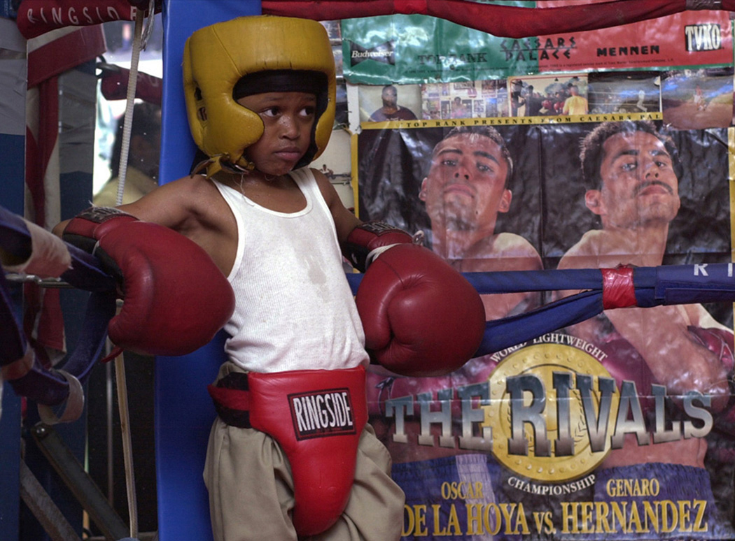 Cat' Daddy Knight stares down his opponent in the opposite side of  the ring.  The seven-year-old has been boxing for three months.