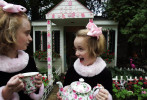 Sisters Suzie, 9, and Sarah Shriber, 7, show off the garden tea house in their backyard. Their mom changes the theme of the house to suit their interests.