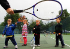 Left to right, David Fletcher, 6, Hallie Pack, 5, Jack Cannon, 5, and Cooper Terrill, 4, watch as instructor Bess Lillmars demonstrates how to hold your racket during a Pee Wee Tennis class for 4 to 6 year olds at Kirkwood City Park. The basic class teaches the kids skills like reaction, balance and control along with serving, forehand and backhand swings.