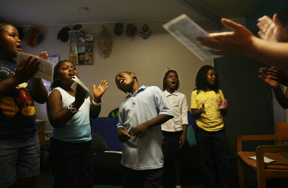 Left to right, Karcia Rich, Jameela Tidwell, Jaren Harrey, Diamond Dent, and Precious Cannon sing {quote}I will call upon the Lord{quote} during church choir practice at the Christian Activities Center in East St. Louis.