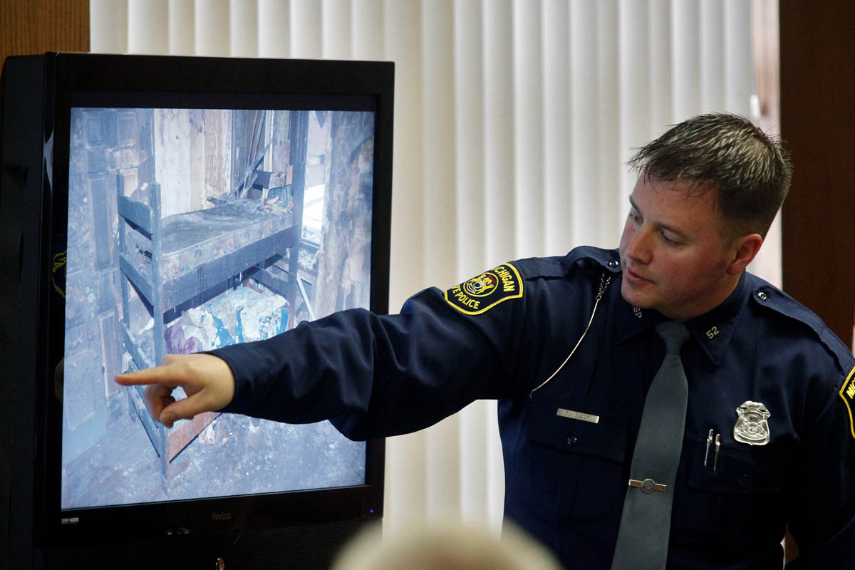 "Michigan State trooper Trever Slater, points in the area of where a dog choke chain and plastic zip ties were used to restrain Calista Springer to her top bunk bed during Anthony and Marsha Springer's trial. Slater was the first officer to report to the fire that engulfed the Springer's home in Centreville. ""She had just enough to wiggle, but not much more than that,"" Slater said. ""(The chain) was tight enough to where it had no play, it couldn't be moved."""