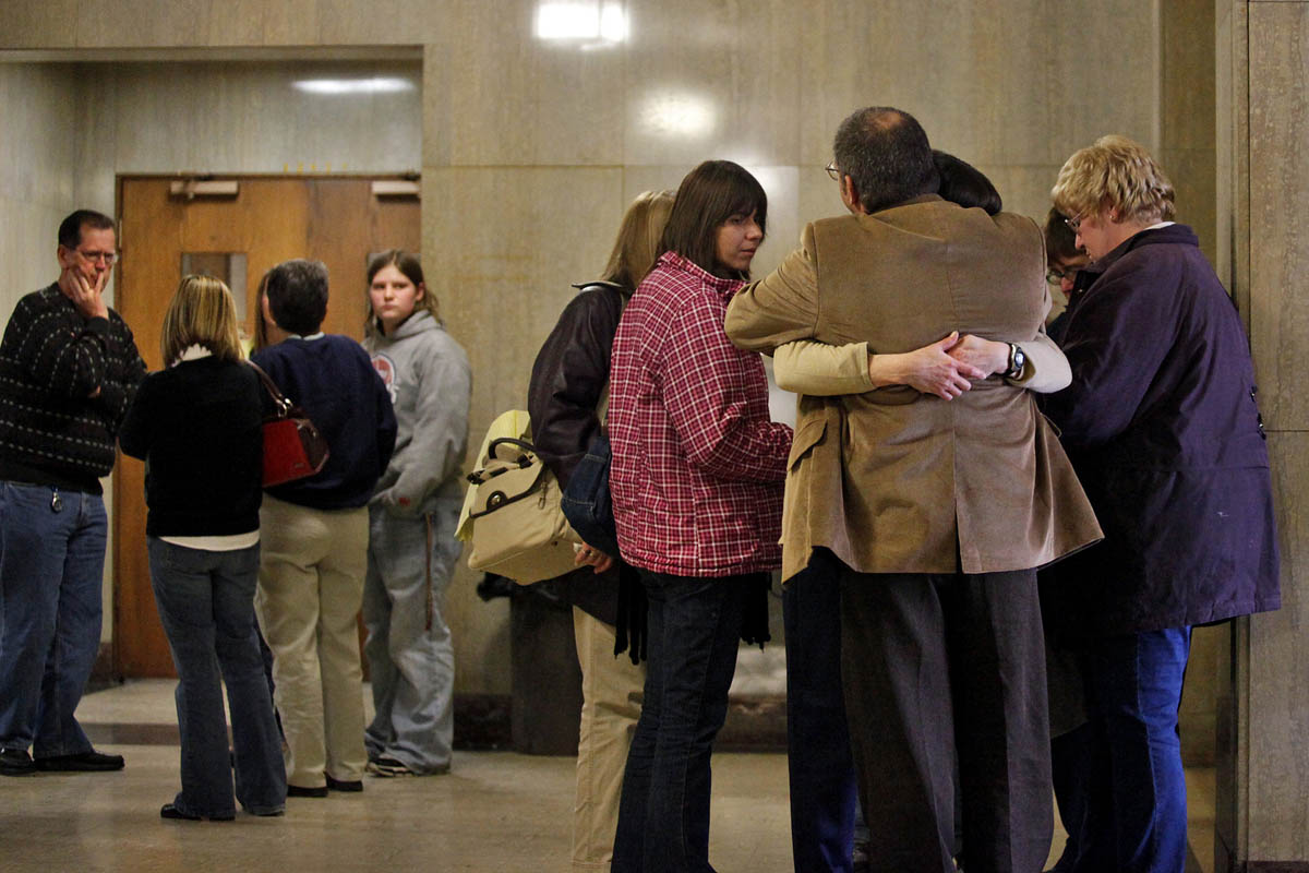 "Anthony Springer, right, receives a hug from his wife Marsha Springer in the hallway outside the Kalamazoo County courtroom during a recess between closing arguments. To the left, Calista's grandparents Dan Langdon, left, Suzanne Langdon, second from left, and friend Cristen Glick watch. ""The hardest thing I've dealt with is the thought that she might have died not knowing that anyone loved her,"" said Dan Langdon."