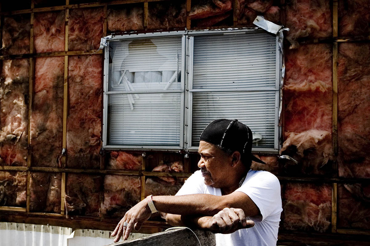 Francisco Ampudiaz takes a break from removing the aluminum siding from his mobile home. Ampudiaz, a tenant of the Franklin Valley Estates mobile home park for eight years, was forced to sell the metal for scrap to help fund with moving expenses.