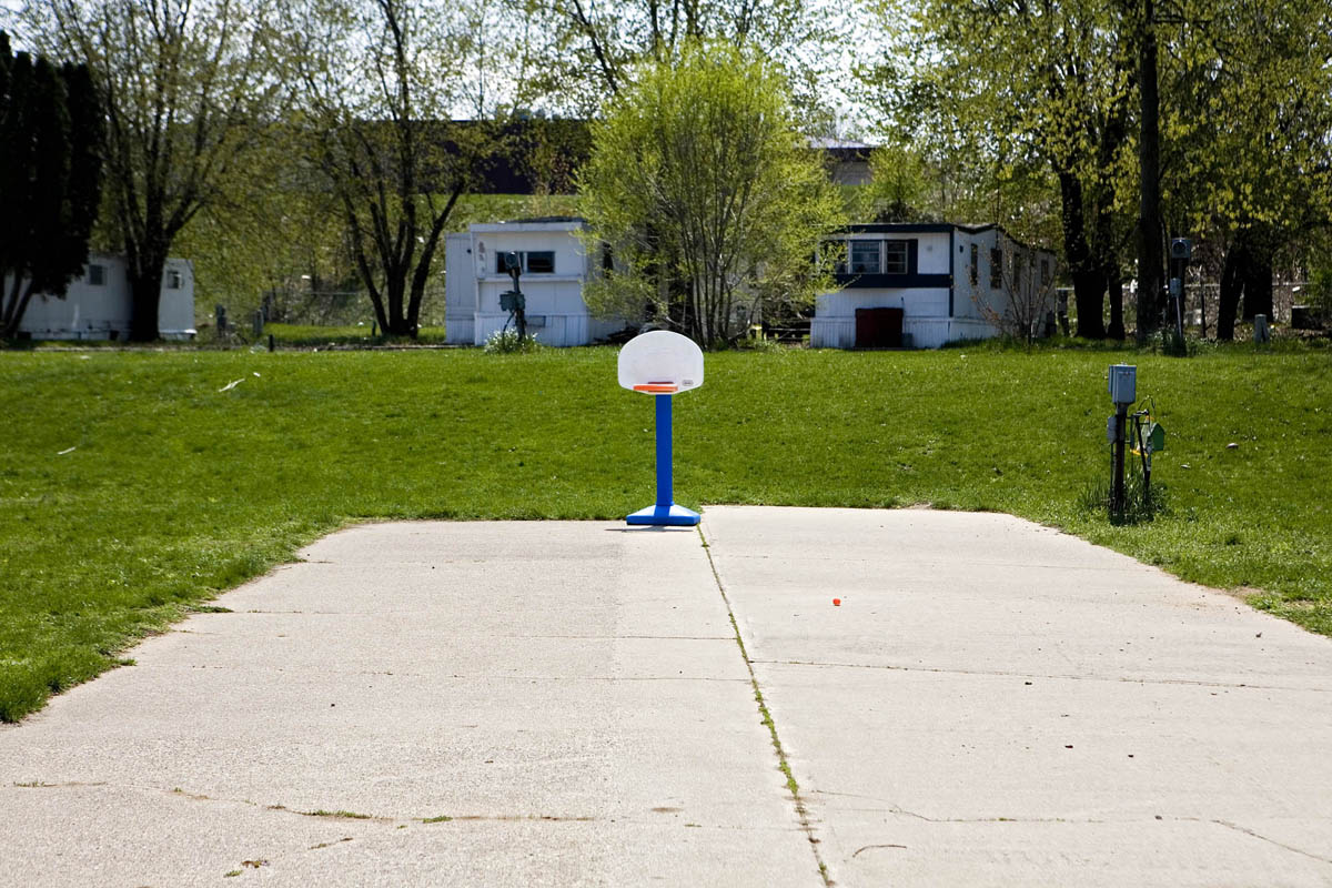 A child's basketball net is all that remains on the concrete that just days prior used to house a mobile home.