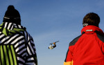 Jay Alley, 19, of Chicago, left, and Brett Conner, 23, right of Allegan, watch as Adam Schrab, center, soars through the air after hitting a jump. Warren Miller Film crews were capturing film of Adam and his twin brother Luke, along with other extreme skiers and snowboarders at Timber Ridge Ski Area for their annual ski movie.