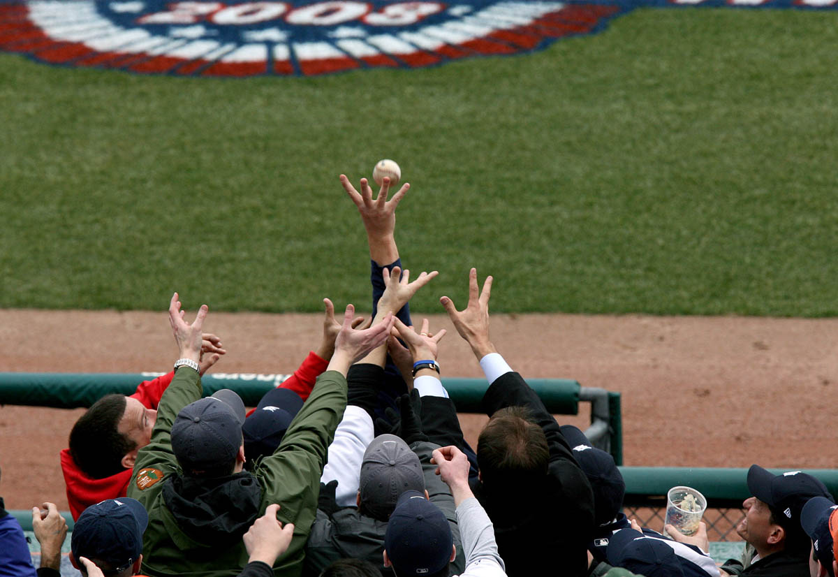 Multiple hands race into the air as a foul ball flies into the stands of Comerica Park during the Detroit Tigers 2008 Opening Day game.