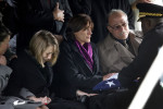 Sarah Pfeiffer, left, begins to cry as Brigadier General Darrell Willams, far right, hands the American flag that covered the casket of U.S. Army Capt. Drew Russell to his parents Patti Russell, center, and Jim Russell. Pfeiffer was dating Drew Russell, who was killed October 8 2011 in the Kandahar Province of Afghanistan.