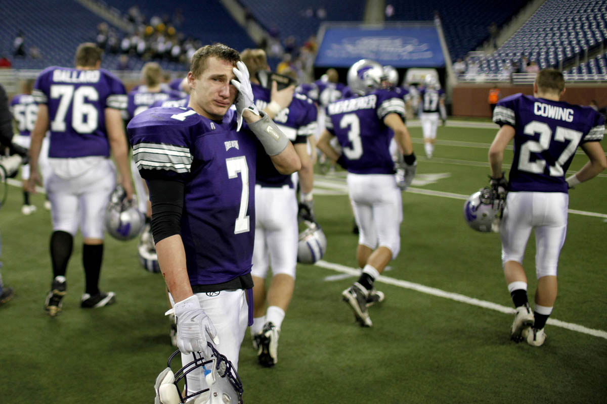 Three Rivers' Drew Shutes, left, looks to the field one last time as his lip begins to quiver after losing to Marshall during the 2009 Division 4 state championship football game at Ford Field.