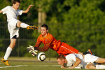 Jamestown goalie Trevor Hartnett, center, dives for the ball in between Lafayette's Jason Eckenrode, left, and David Lees during the Region I soccer tournament semifinal game.