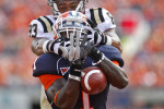 University of Illinois' Terry Hawthorne, center, attempts to intercept a ball intended for Western Michigan University's Jordan White during the September 24 game at Memorial Stadium.