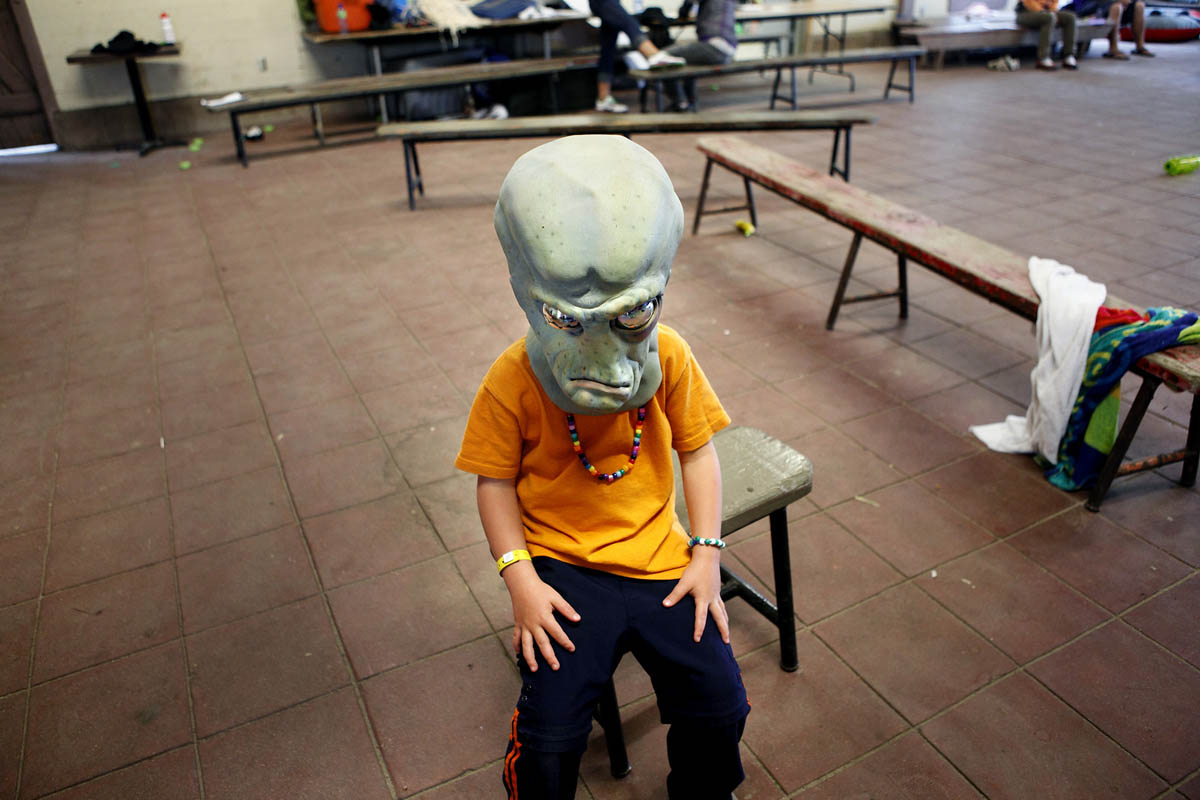 Isaac Hemmes, 6, of North Dakota wears a mask while waiting for other groups members to choose costumes before performing a skit during a drama group program. Hemmes and over a hundred other children were at YMCA Camp Eberhart in Three Rivers for Operation Purple, a week long free summer camp for children whose parents are deployed or about to be deployed in the military.