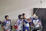Members of the USS Abraham Lincoln hockey team take selfies before the start of Saturday's Air vs. Sea hockey game at the Scope Arena in Norfolk on January 30, 2016.