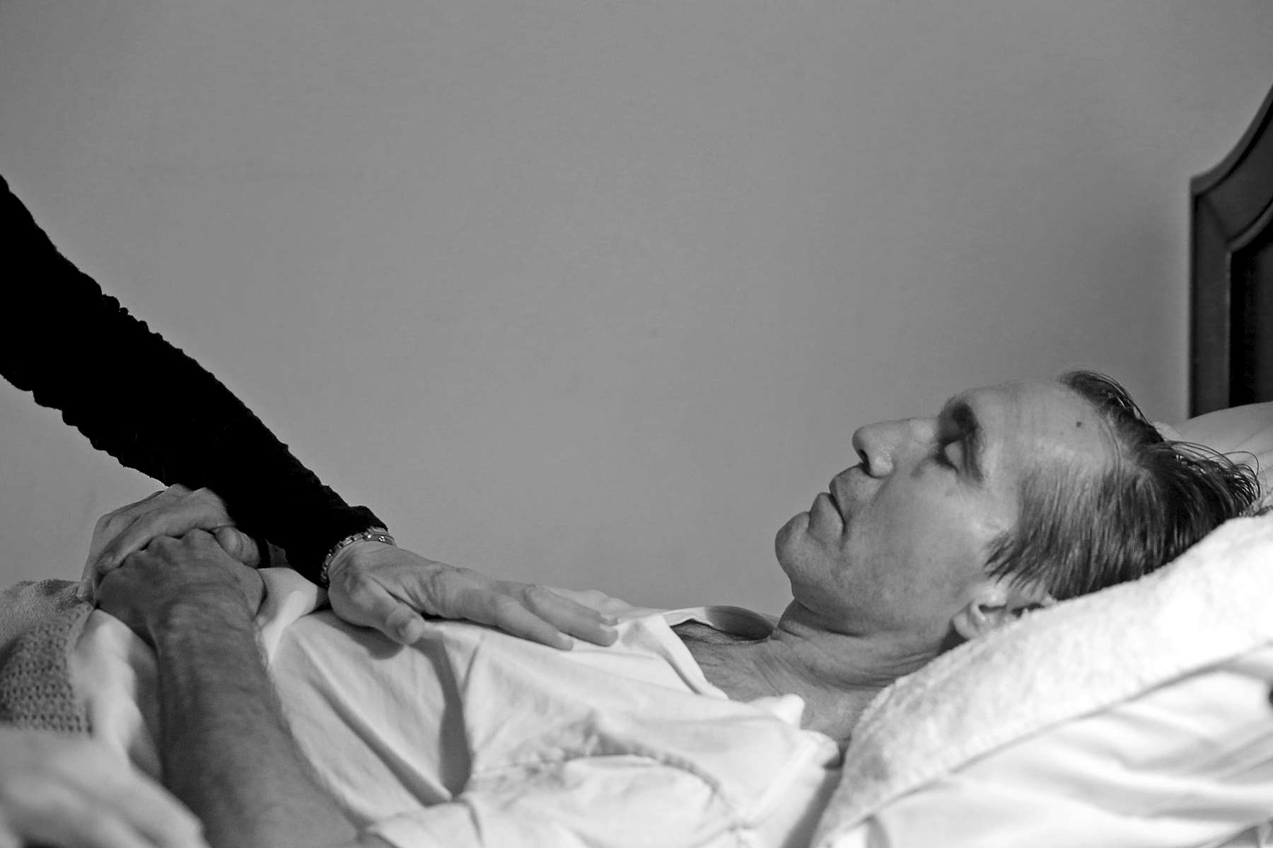 Karen Garner comforts Jim as he lays in bed at Commonwealth Assisted Living in Hampton Saturday March 26, 2016. Jim died from Alzheimer's April 2, 2016. Jim was diagnosed by the National Institute of Health in 2011 with {quote}mild cognitive impairment,{quote} the precursor to early-onset Alzheimer's disease. The genetically pre-determined disease has devastated his family--his mother died of the disease at age 61, his older brother at 52.