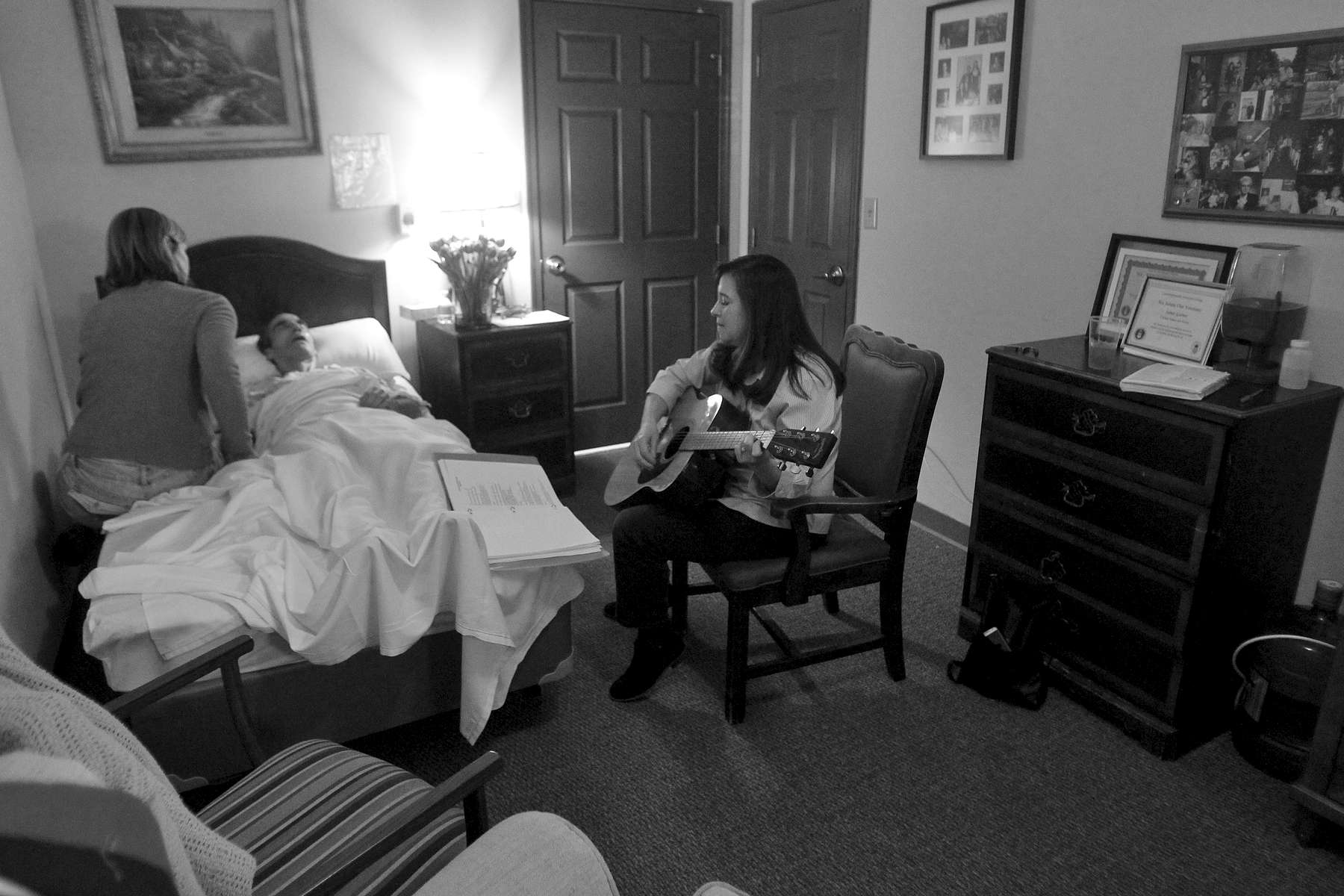 Shelly Simonds plays guitar for Jim as he lays in bed at Commonwealth Assisted Living in Hampton Monday afternoon March 28, 2016. Jim died from Alzheimer's April 2, 2016. Jim was diagnosed by the National Institute of Health in 2011 with {quote}mild cognitive impairment,{quote} the precursor to early-onset Alzheimer's disease. The genetically pre-determined disease has devastated his family--his mother died of the disease at age 61, his older brother at 52.