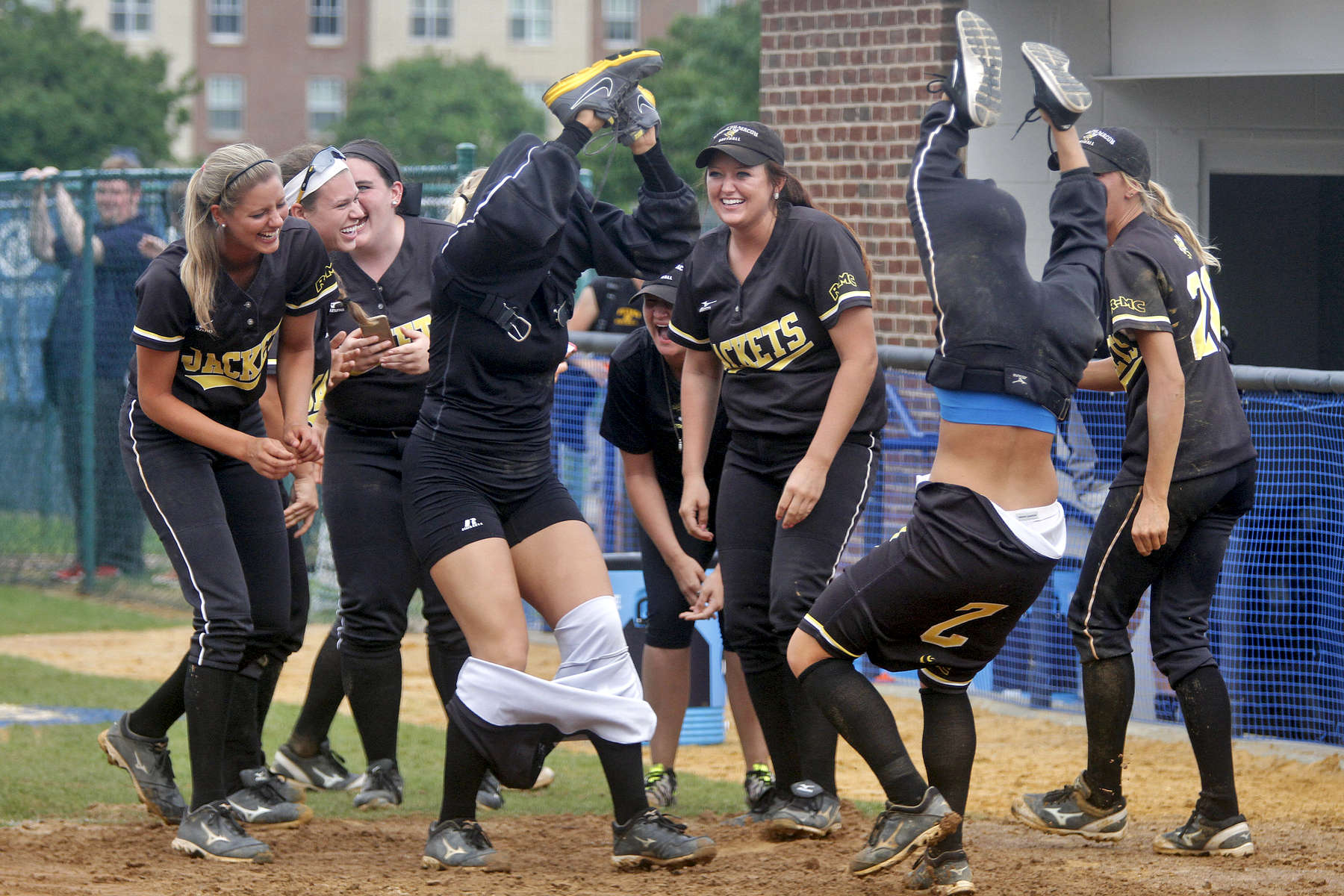 Randolph-Macon players attempt to pass the time while a rain delay during Sunday's NCAA Division III regional tournament championship against Christopher Newport University on May 10, 2015.