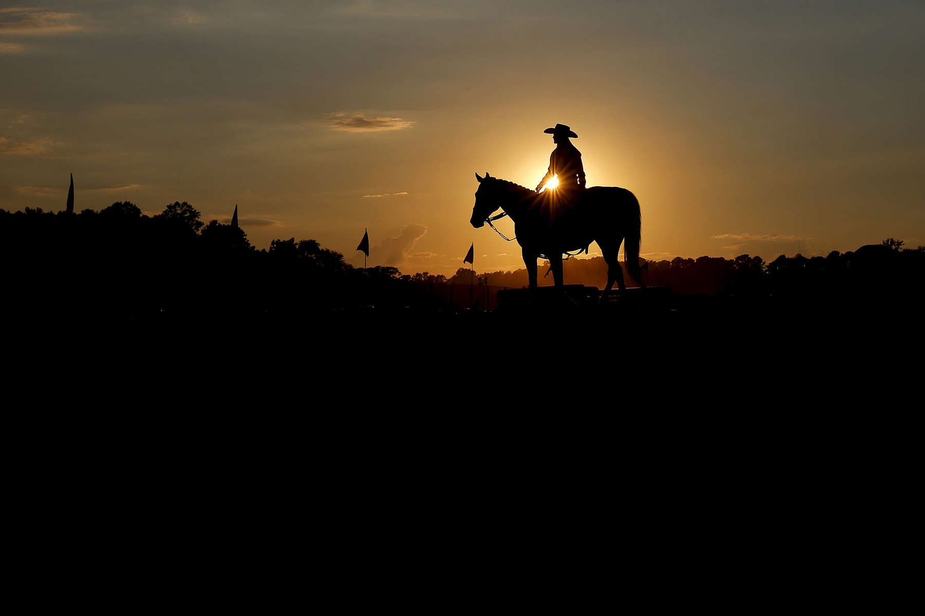 A woman waits on her horse after competing in the barrel racing competition during the Championship Rodeo presented by True Grit Rodeo Company at the Isle of Wight County Fair Saturday evening September 16, 2017.