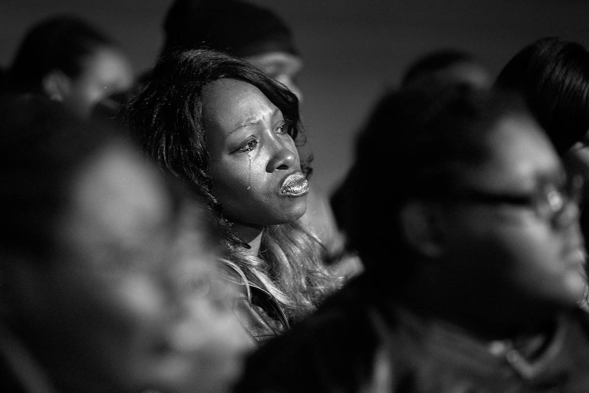 Rita Thornton begins to cry during a vigil for Isaac Oshin outside Majik City Gentlemen's Club and Sports Bar Friday evening. Dozens of people gathered outside the club to remember Isaac Oshin who was shot to death inside the club at 5825 Jefferson Avenue Wednesday evening.